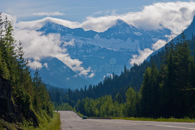Trans canada highway. Cloud enshrouded mountains, and the trans canada highway, revelstoke national park, british columbia, canada royalty free stock images