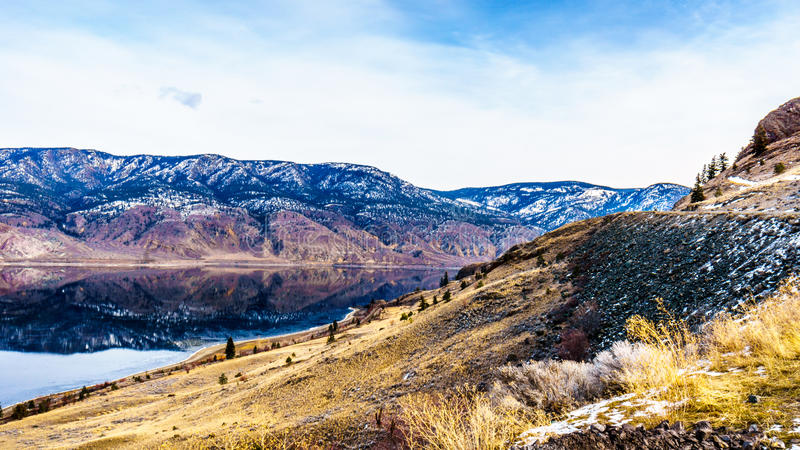Trans Canada Highway and the Rail Road runs along Kamloops Lake. Trans Canada Highway and Railways runs along Kamloops Lake. The lake is a very wide portion of royalty free stock photos