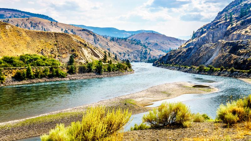 The Trans Canada Highway winding through the mountains and along the Thompson River. Between the towns of Cache Creek and Spences Bridge in central British royalty free stock photography