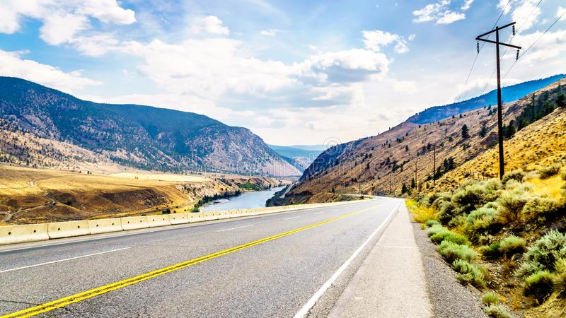 The Trans Canada Highway winding through the mountains and along the Thompson River. Between the towns of Cache Creek and Spences Bridge in central British stock images