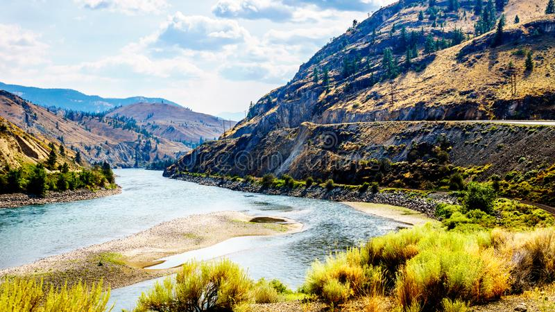 The Trans Canada Highway winding through the mountains and along the Thompson River. Between the towns of Cache Creek and Spences Bridge in central British royalty free stock image