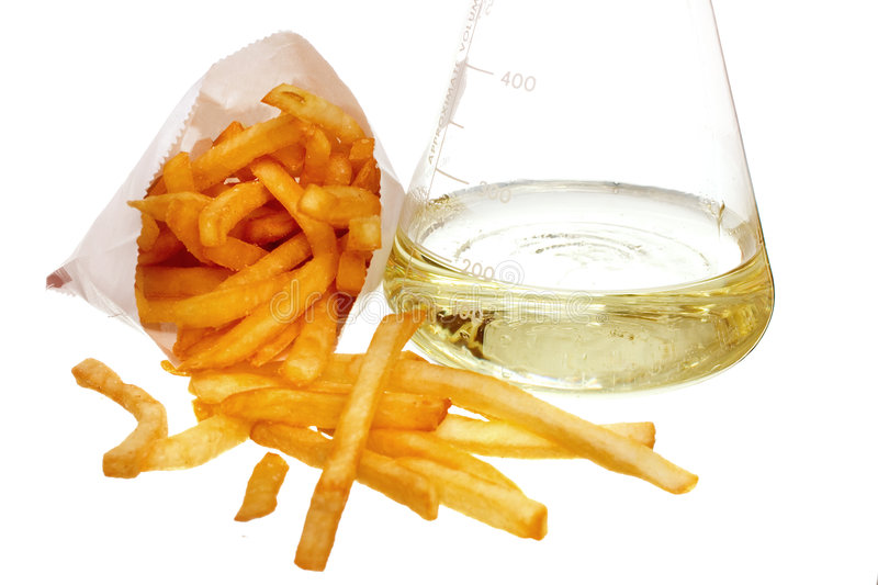 Trans fat concept. French fries and flask full of liquid oil trans fat on white ground royalty free stock photos