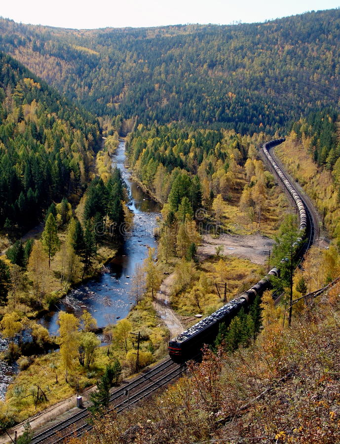 The TRANS-Siberian railway at the river Olkha in the Baikal region. The TRANS-Siberian railway to the Baikal pass station Irkutsk-Slyudyanka between the stopping royalty free stock photography