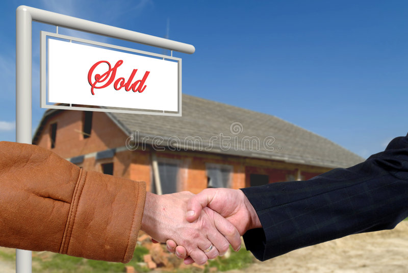 Transactie, handdruk op huisverkoop stock fotografie