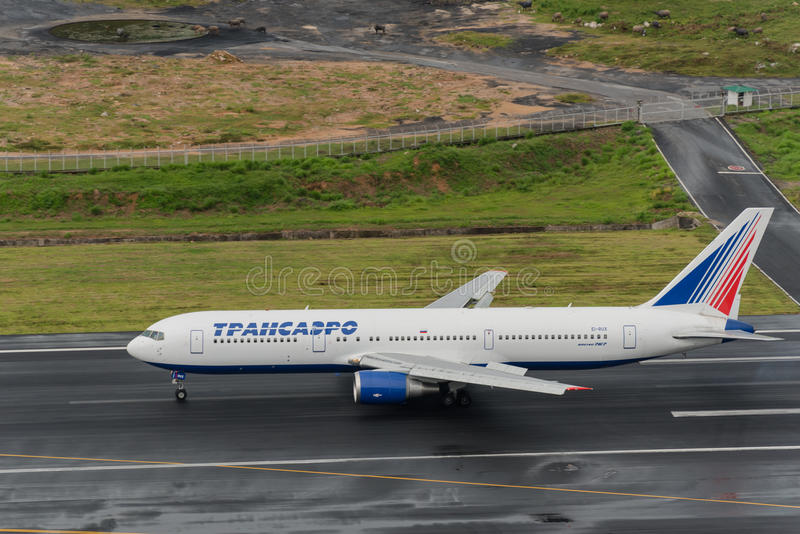Transaero airline take off at phuket airport. Phuket, Thailand ; September 17 2015. Transaero airway airline Boeing 763 Landing at phuket airport in rainny day royalty free stock photography