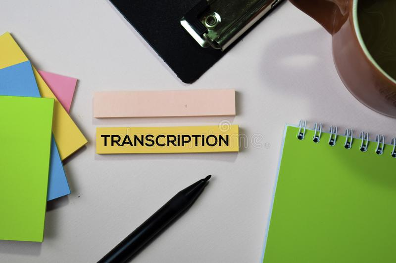 Transcription text on sticky notes with office desk concept royalty free stock images