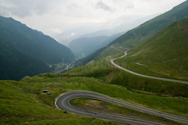 Transfagarasan. This is Transfagarasan, the second highest road in Romania, the place where the mountains touch the sky. A place as beautiful as it is savage and royalty free stock photos