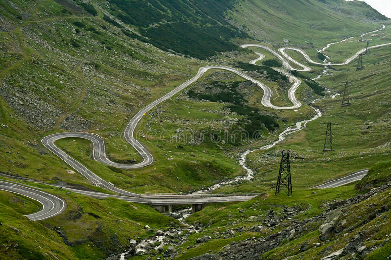 Transfagarasan. This is Transfagarasan, the second highest road in Romania, the place where the mountains touch the sky. A place as beautiful as it is savage and stock image