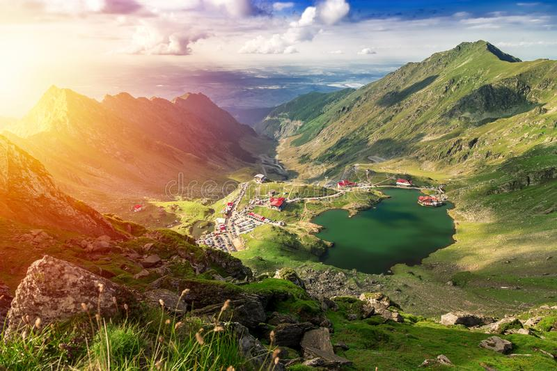 Transfagarasan Balea glacier lake. Above view of lake Balea in F. Agaras mountains on a bright sunny day stock image