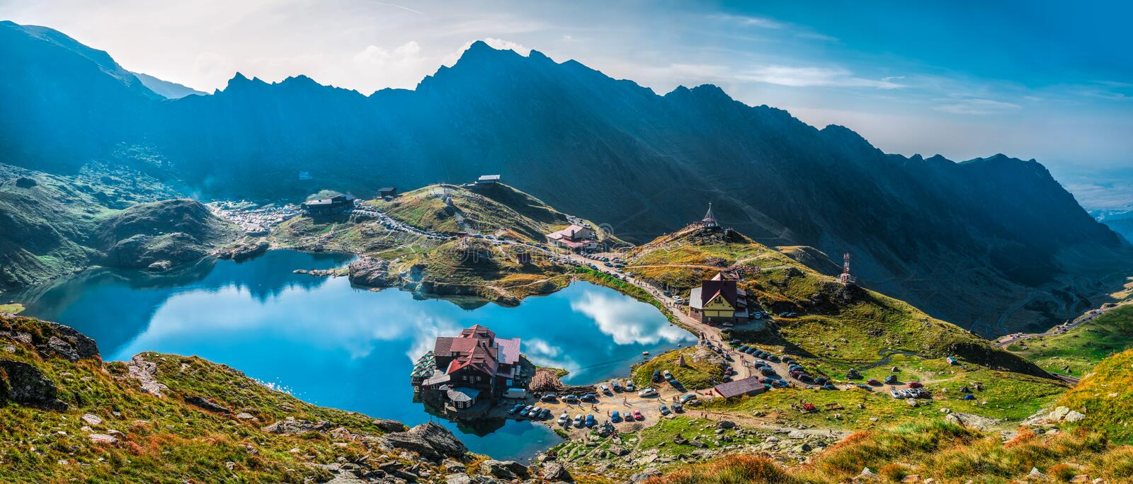 Balea Lake in Romania. Scenic view of Balea lake in the Fagaras mountains, CarÈ›iÈ™oara, Sibiu County, Romania royalty free stock image