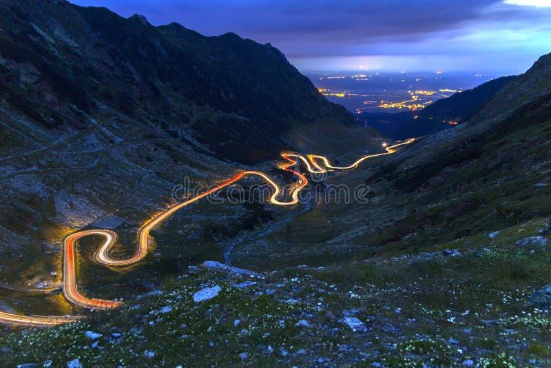 TRANSFAGARASAN ROAD AT DUSK. TRANSFAGARASAN HIGHWAY ROAD WITH LIGHT TRAILS AT DUSK stock images