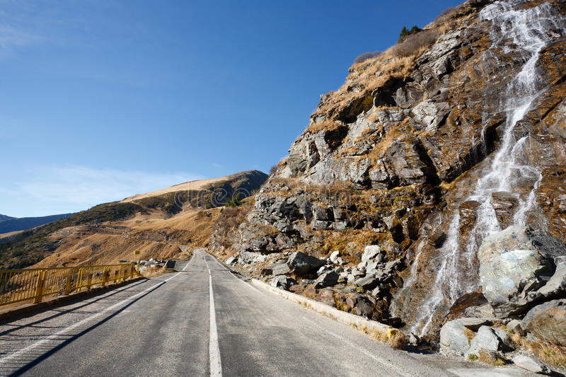 Transfagarasan road in Romania. Landscape with Transfagarasan, a famous road in Romania, crossing the mountains, near a small waterfall royalty free stock photography