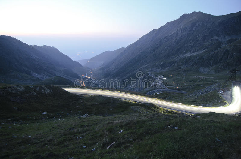 Transfagarasan road at sunset. Transfagarasan road - the most famous road in Romania, breaking through the mountains royalty free stock photo