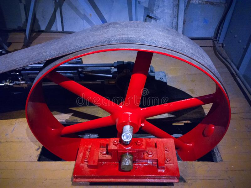 Transfer of Power. Wheel and belt that transfer steam generated power to the paddle wheel of a riverboat steamer royalty free stock images