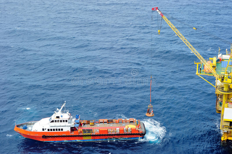 Transferring offshore personnel to the oil platform royalty free stock photo