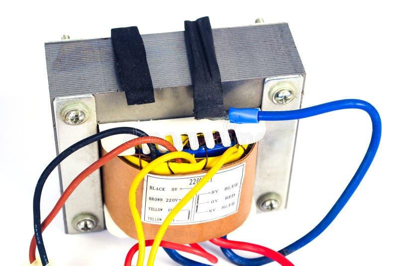 Transformadores de poder para proveer electrónico en el fondo blanco fotos de archivo libres de regalías