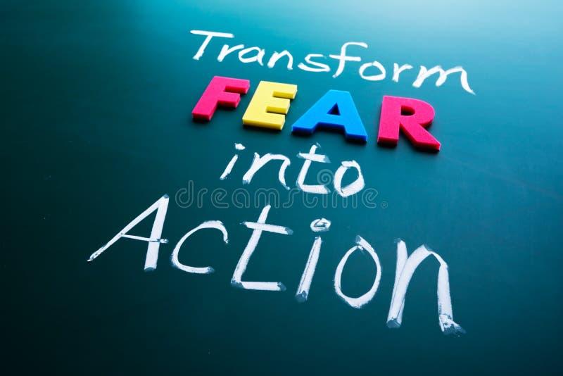 Transforme o medo no conceito da ação imagem de stock royalty free