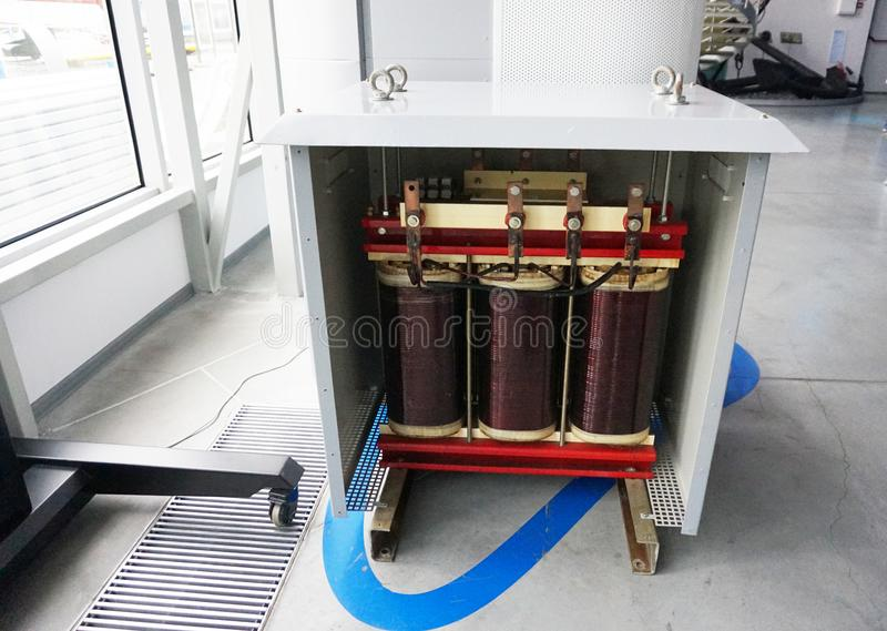 Transformer with electric motor coil, in modern production room stock image