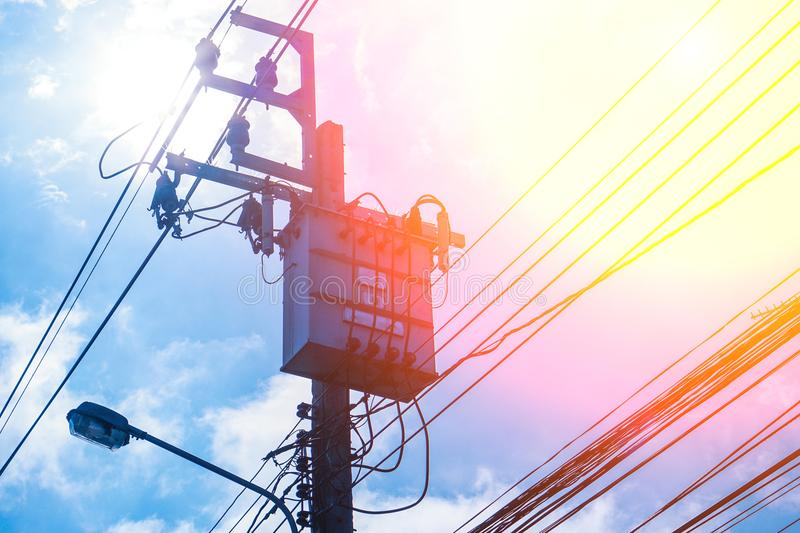 Transformer High voltage electricity pole and power line with blue cloudy sky background. Transformer High voltage electricity pole and power line with blue royalty free stock images