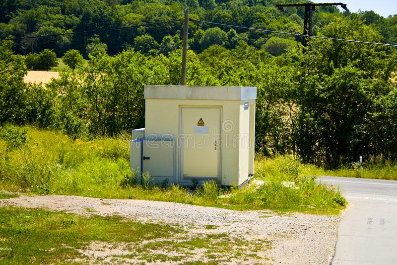 Transformer house of the electricity supplier on a country road stock image