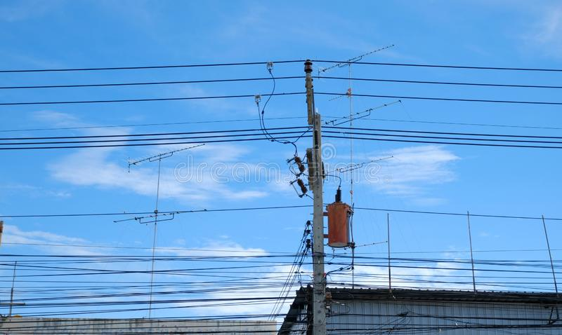 Transformer on the pole One-phase transformer For high voltage electricity conversion into low voltage electricity in rural areas stock image