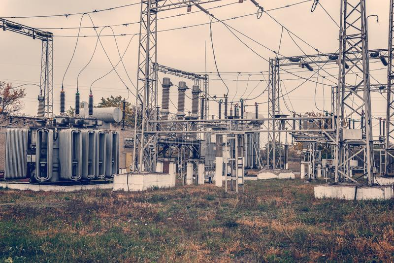 Transformer substation, high-voltage switchgear and equipment. HDR photo of an electric station with poles and wires. royalty free stock image