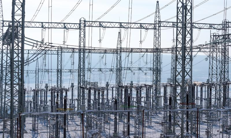Transformer substation in the winter. Equipment used to raise or lower voltage, high voltage power station royalty free stock photos
