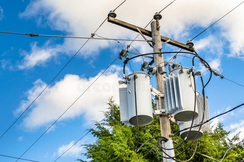 Electric Transformers at the Top of a Wooden Pole stock photography