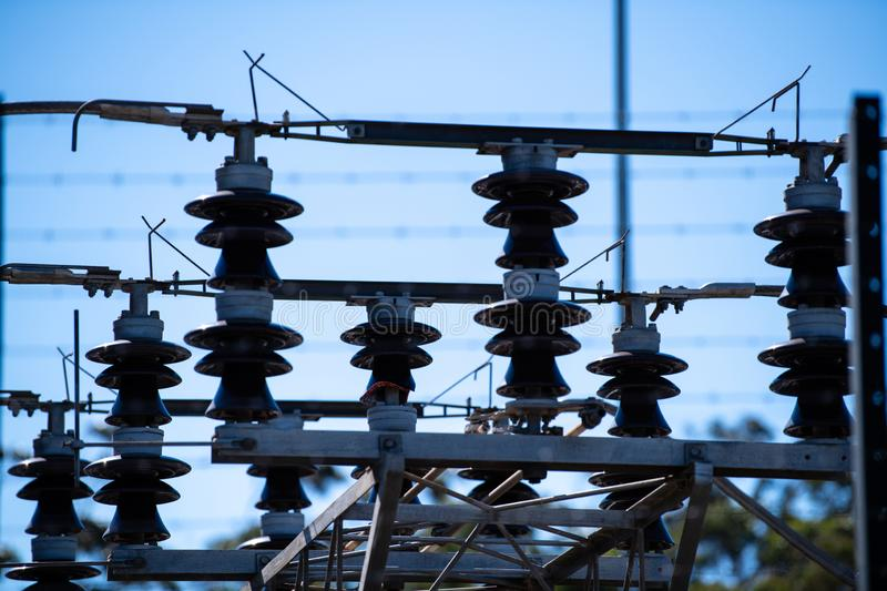 Transformers and insulators at a power electrical sub station stock photography