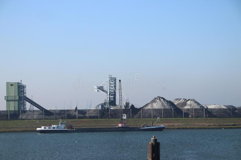 Transhipment plant for bulk transport like ore of coal in the Europoort harbor in the port of Rotterdam.. Transhipment plant for bulk transport like ore of coal royalty free stock photography