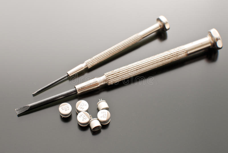Transistors. Two Screwdrivers and Small Transistors stock photo