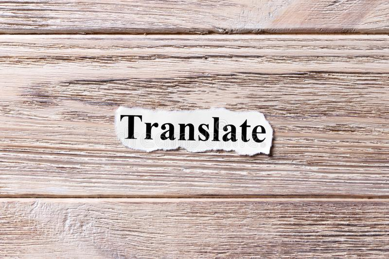 Translate of the word on paper. concept. Words of Translate on a wooden background.  royalty free stock image