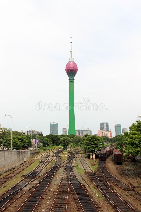 Translation: Colombo Lotus Tower, while a train is arriving. Taken in Sri Lanka, August 2018 stock photography