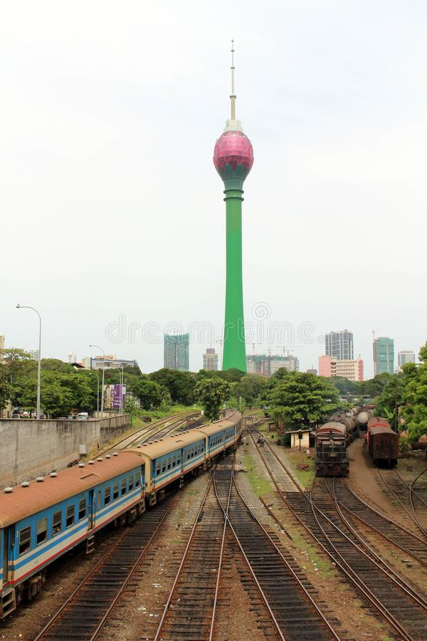 Translation: Colombo Lotus Tower, while a train is arriving. Taken in Sri Lanka, August 2018 royalty free stock image