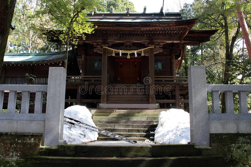 Translation: `Oyama Shrine`. It was covered by light snow stock images