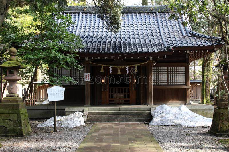 Translation: `Oyama Shrine`. It was covered by light snow royalty free stock photography