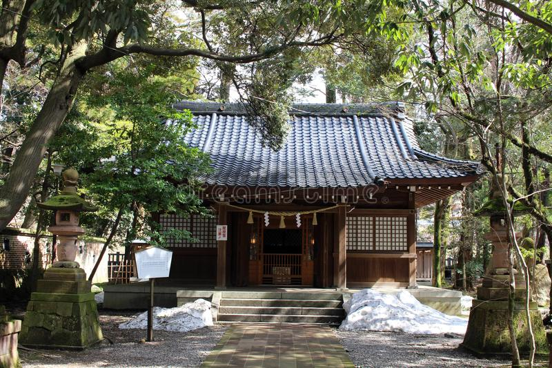 Translation: `Oyama Shrine`. It was covered by light snow stock photography