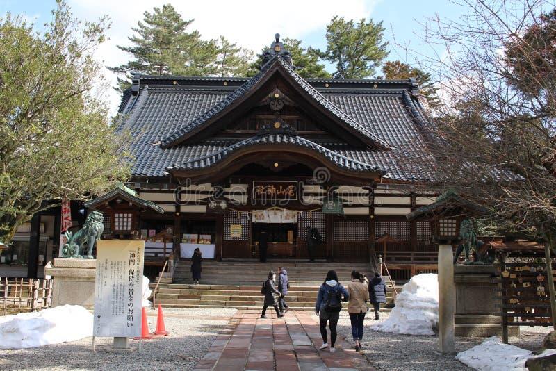 Translation: `Oyama Shrine`. It was covered by light snow. Taken in Kanazawa, Japan - royalty free stock photos