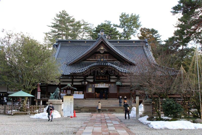 Translation: `Oyama Shrine`. It was covered by light snow. Taken in Kanazawa, Japan - stock photo
