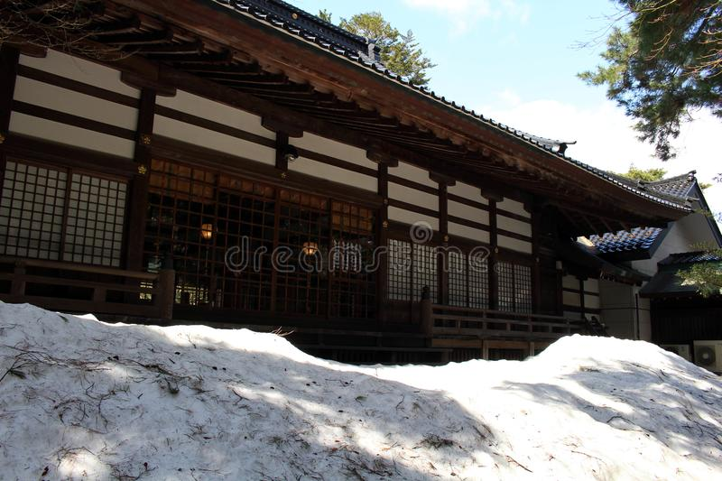 Translation: `Oyama Shrine`. It was covered by light snow stock photo