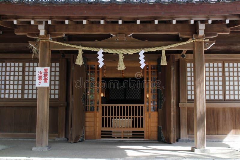 Translation: `Oyama Shrine`. It was covered by light snow stock photos
