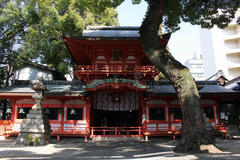 Translation: A small Shinto shrine in the middle of Nagoya city. Center. Taken in Japan, February 2018 stock photos