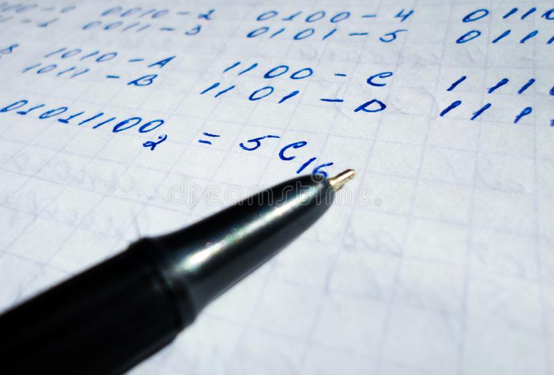 Translations of calculus systems on a notebook and black pen. creation of computer programs. work of the programmer and. Java program in notepad and black pen royalty free stock photo