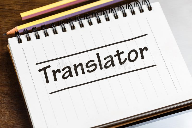 Translator on Notebook. Closeup Translator word on small notebook on the desk royalty free stock photo
