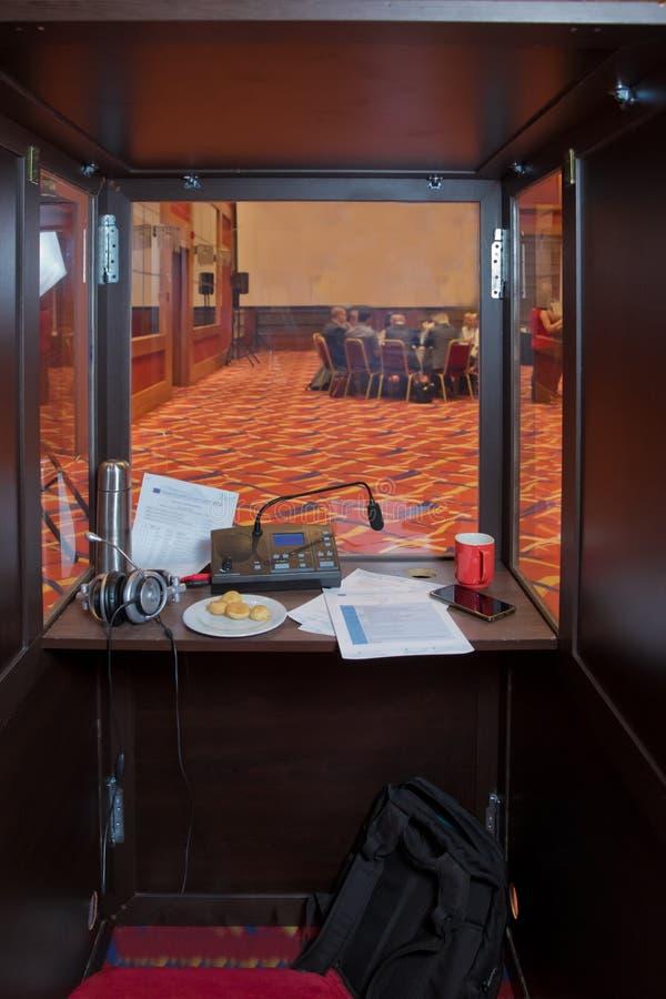 Translator room . translators cubicle . interpreting - Microphone and switchboard in an simultaneous interpreter booth . Soft focu. Translators cubicle stock photo