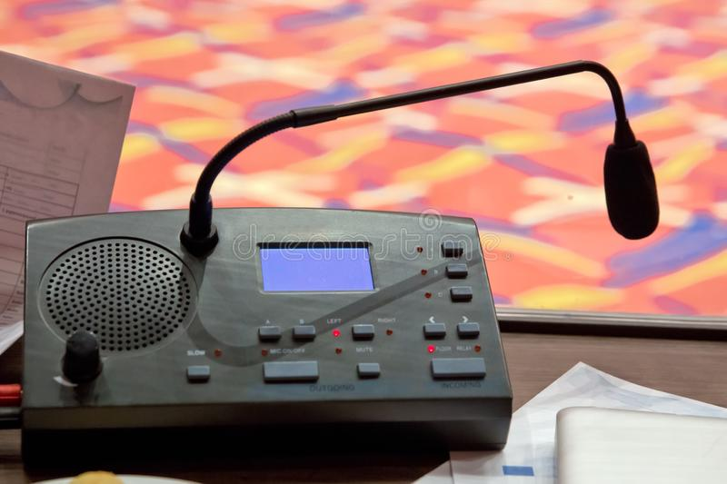 Translator room . translators cubicle . interpreting - Microphone and switchboard in an simultaneous interpreter booth . Soft focu. Translators cubicle royalty free stock photos