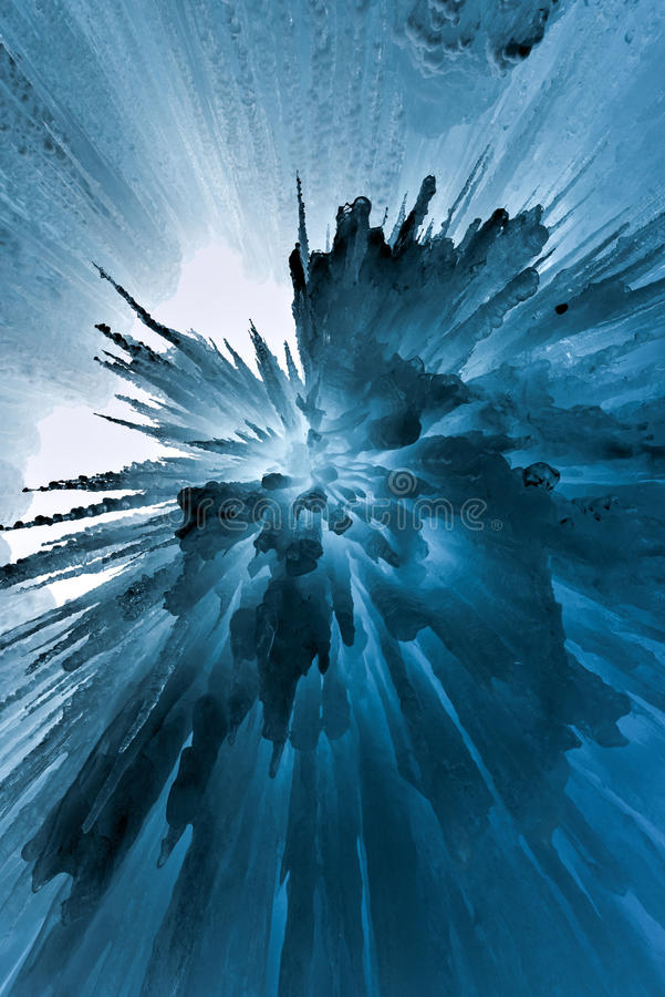 Translucent Blue Ice Castle. Translucent blue icicles in a frozen ice wall royalty free stock image