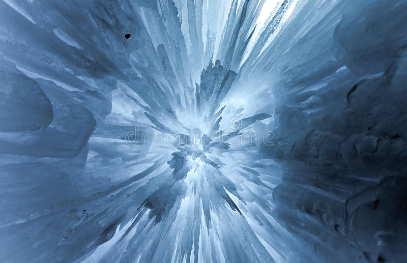 Translucent Blue Ice Castle. Translucent blue icicles in a frozen ice wall stock photo