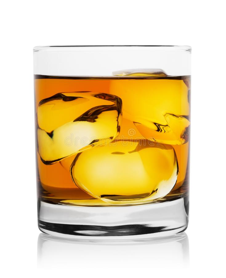 Translucent gold whiskey with ice cubes in glass stock photos