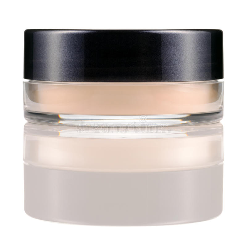 Translucent loose powder in a jar. Translucent face loose powder in a jar isolated on white background. Make-up product with silk stock photo